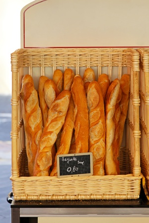 Traditional French baquette bread in the basket Stock Photo - 12351191