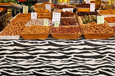 Dried fruits and nuts at market stall photo