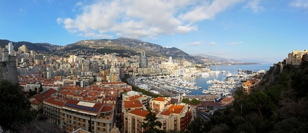 carlo: MONTE CARLO, MONACO - JANUARY 18: Hercules harbour panorama in Monte Carlo on JANUARY 18, 2012. Aerial photo of Hercules harbour and La Condamine panorama in Monte Carlo, Monaco.