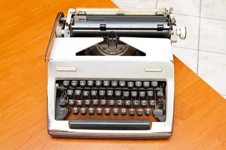 Retro style typewriter at office desk photo