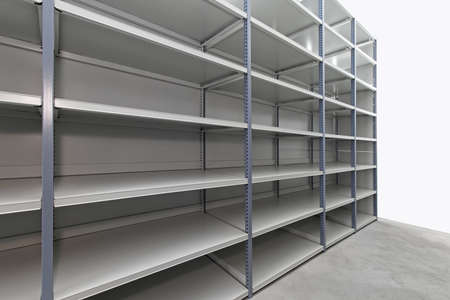 Empty metal shelf in storage room photo