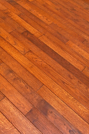 wood flooring: Wood parquet floor with diagonal boards Stock Photo