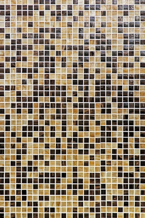 mosaic wall: Brown and beige small mosaic wall tiles Stock Photo