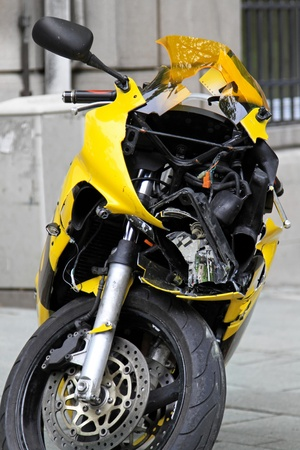 bad accident: Unrecognizable motorcycle in bad traffic accident