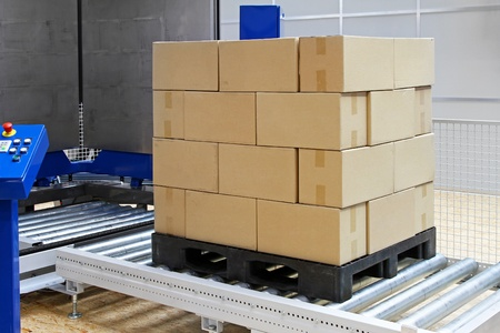 Cardboard boxes at transport pallet package machine Stock Photo - 12677539