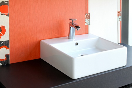 Modern square bathroom sink and red wall Stock Photo - 12880151
