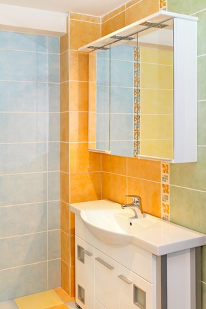 Small bathroom inter with modern orange tiles Stock Photo - 12880116