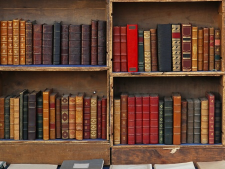 Bookcase: Vintage books in old bookcase Stock Photo