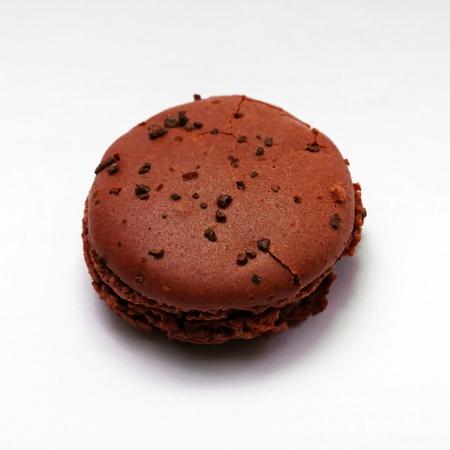 One brown chocolate macaron cookie photo