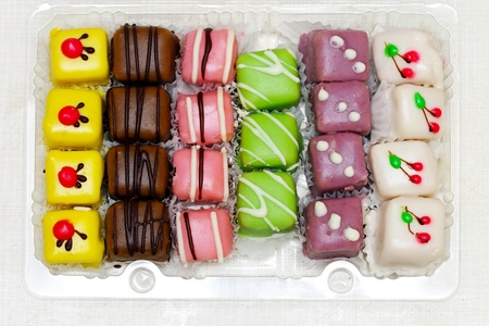 Colorful variety of mignon cakes in the box Stock Photo - 12974294