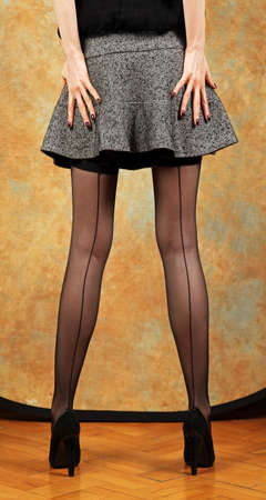 skirt: Sexy woman legs with black seam stockings