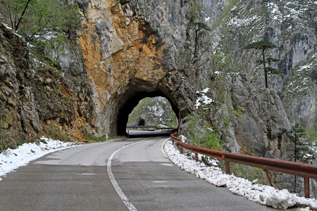 Curvy road trough tunnel in Montenegro mountains photo