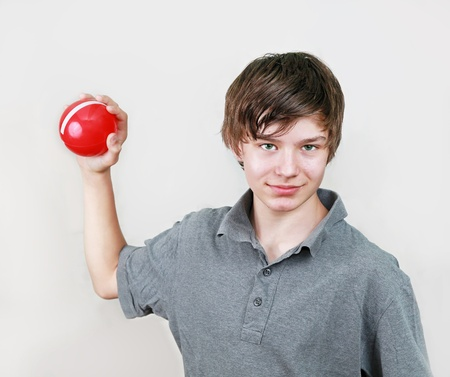hansome: Hansome young boy with red ball