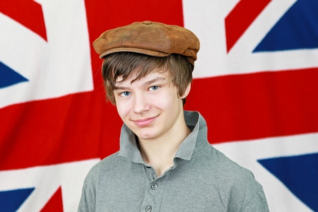 Young British boy with hat in front of Union Jack national flag photo