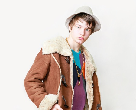 pimp: Teenage boy pimp in gang style with coat and hat