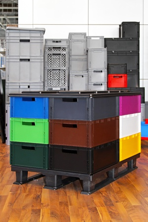 Colourful plastic crates and boxes at transportation pallet Stock Photo - 13915880
