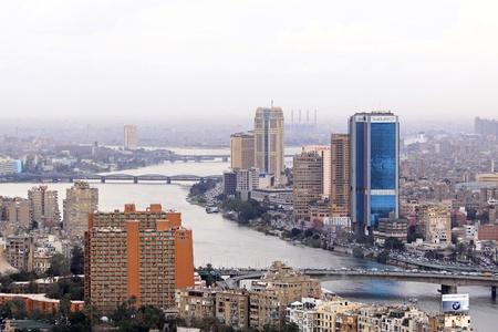 nile river: CAIRO, EGYPT - FEBRUAR 25: Cityscape with National Bank of Egypt in Cairo on FEBRUAR 25, 2010. Cityscape with National Bank big blue buildings in Cairo, Egypt