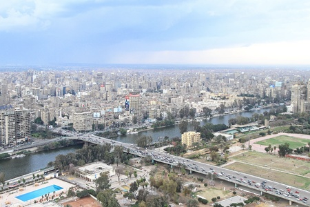 nile river: CAIRO, EGYPT - FEBRUAR 25: West Cairo from tower on FEBRUAR 25, 2010. West city and 6th October Bridge at River Nile in Cairo, Egypt.