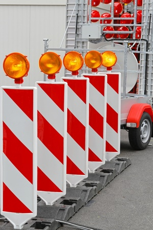 Road barrier with amber beacon flashing lights Stock Photo - 20355511