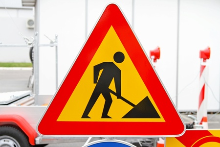 Road works triangular traffic sign at construction site Stock Photo - 20355402