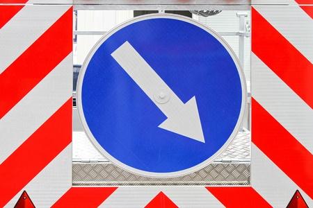 signaling: Direction arrow sign signaling traffic diversion