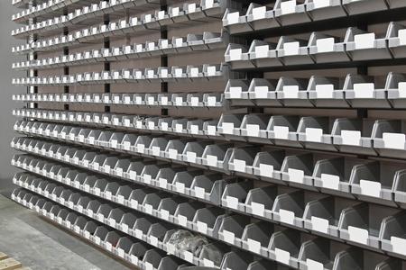 Gray tray bins at wall in storage room photo