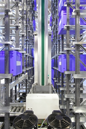 Automated storage warehouse system with plastic crates photo
