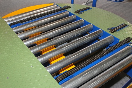 Conveyor rollers for moving goods through factory line Stock Photo - 20459111