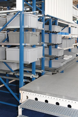 Plastic crates and boxes in storage shelving photo