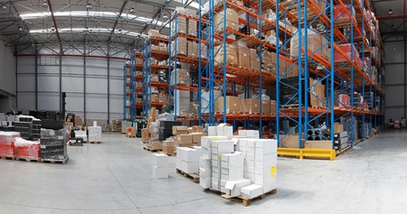 Distribution warehouse with high rack shelving system panorama Stock Photo