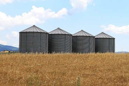 Four steel grain silo towers in rural Greece Stock Photo - 20459117