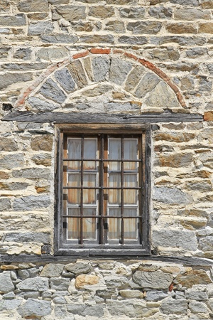 Window with bars at medieval Ouranopoli tower Stock Photo - 20470055