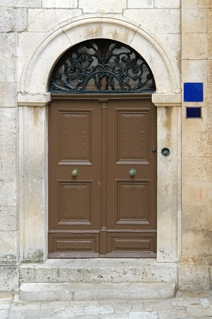 Brown arch door at medieval house Stock Photo - 20470068