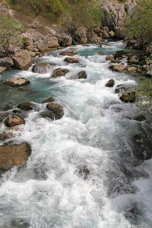 White foam at speed mountain river stream Stock Photo - 20470858