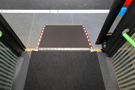 Retractable ramp for wheelchair at city bus Stock Photo - 20471576