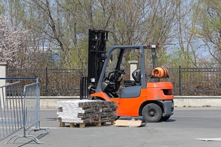 Gas powered forklift and pallet with package Stock Photo - 20470058