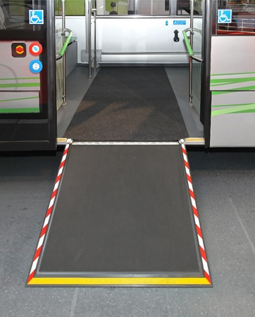 wheelchair access: Door and ramp for wheelchair at city bus