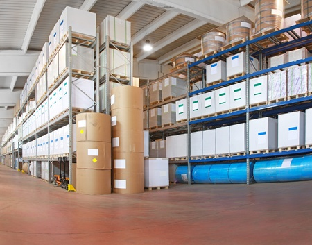 Distribution warehouse with paper rolls and material for printing