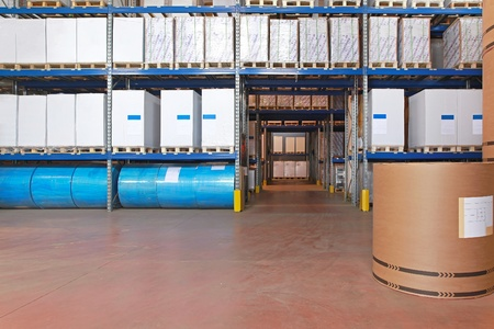 Distribution warehouse with paper rolls and printing material photo