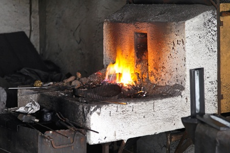 ancient blacksmith: Blacksmith forge and high temperature fire pit Stock Photo