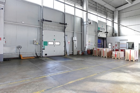 Cargo loading door in distribution warehouse photo