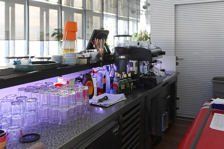 establishment: Behind bar interior establishment that serves alcoholic drinks
