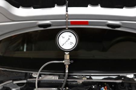 Petrol engine automotive compression test gauge service Stock Photo