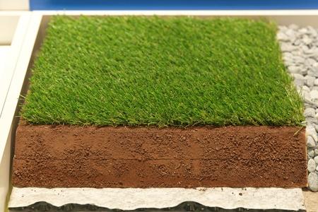 pasto sintetico: Las capas de c�sped sint�tico artificial para campos de deportes