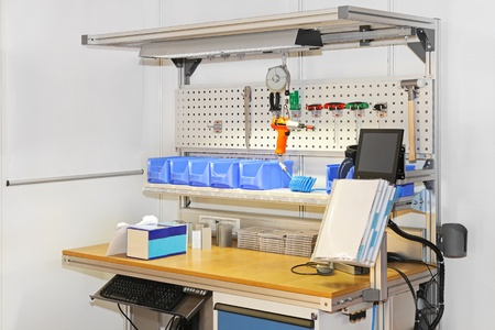 Technician workbench desk with tools and shelves photo