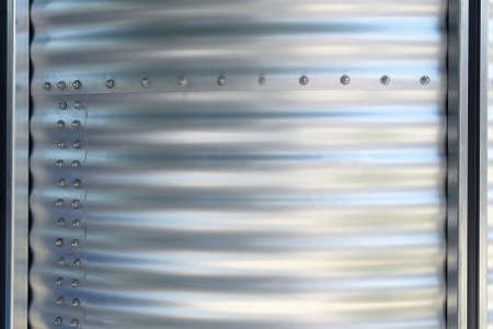 galvanised: Corrugated galvanised iron metal with bolts Stock Photo