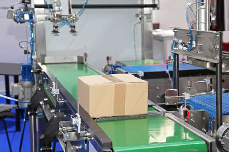 Conveyor belt at packaging line in factory Stock Photo