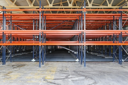 Metal shelves for pallets in distribution warehouse photo