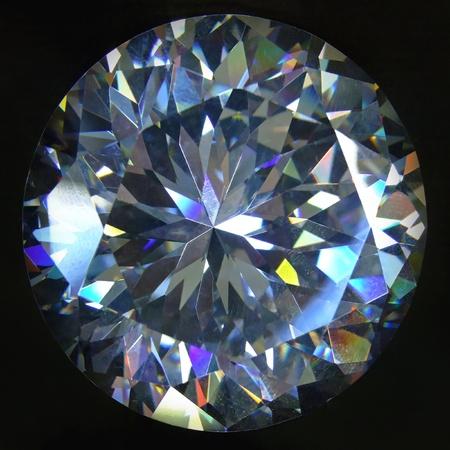 fake diamond: Artificial round brilliant cut diamond at black background Stock Photo