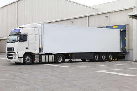 loading bay: White box semi trailer at warehouse loading bay dock